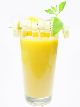 banana fruit yellow smoothie cocktail decorated by mint Stock Photo