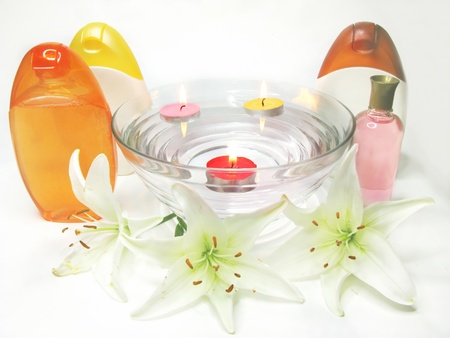 spa hair mask creme liquid soap candles essenses and white lily photo