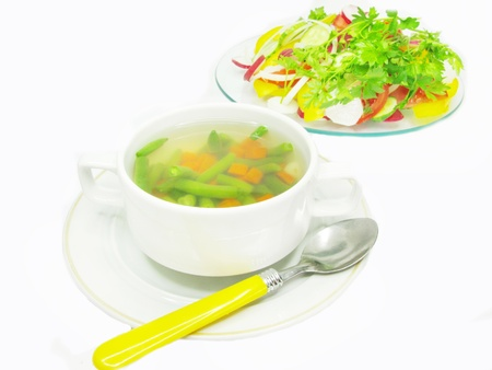 leguminous: soup with haricot leguminous bean carrot and vegetable salad on background Stock Photo