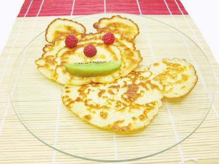 sweet pancake with raspberry and kiwi animal face creative food
