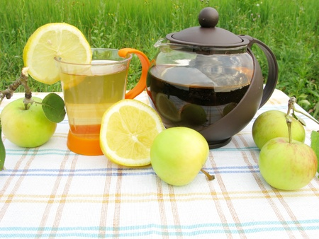fruit tea with apple and lemon outdoors photo