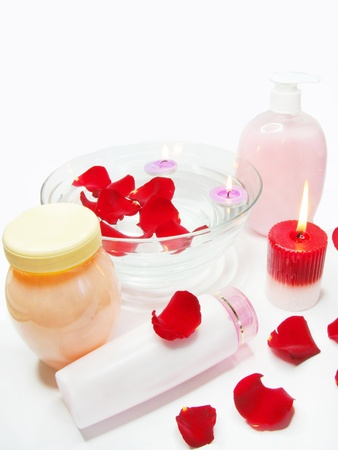 spa hair mask creme liquid soap candles essenses and red rose petals photo