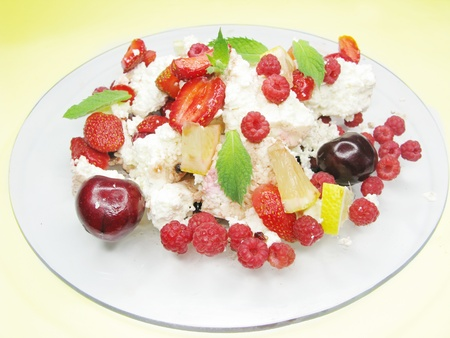 fruit salad with curd strawberry cherry rspberry and other fruits photo