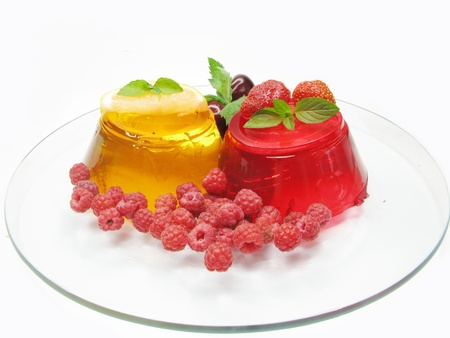 yellow and red fruit jelly dessert with raspberry and lemon photo