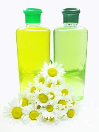 two bottles of herbal shampoo yellow and green photo