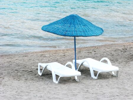 sunbeds: sun-tent and and couple of sun-beds on the beach