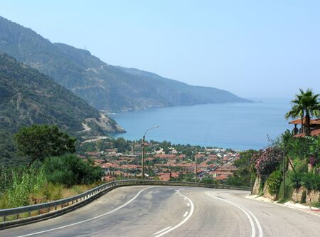 road to famous sea resort among high mountains photo