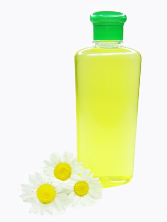 yellow herbal shampoo with daisy natural extract photo