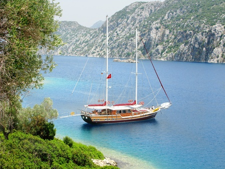 aegean sea landscape view of yacht in sea among high mountains photo