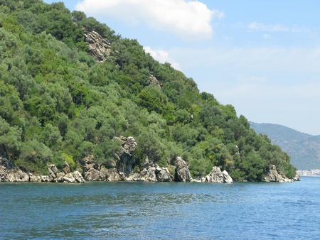 woody bay: aegean sea landscape view of green mountains Stock Photo