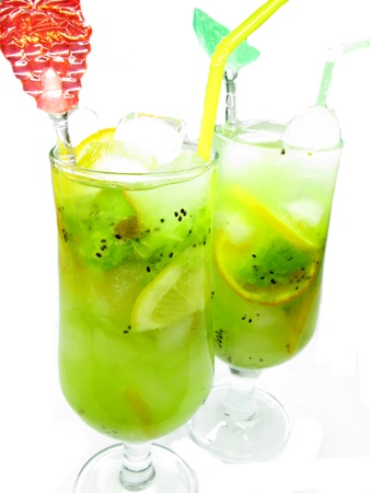 glasses of fruit cocktail smoothie with kiwi and ice photo
