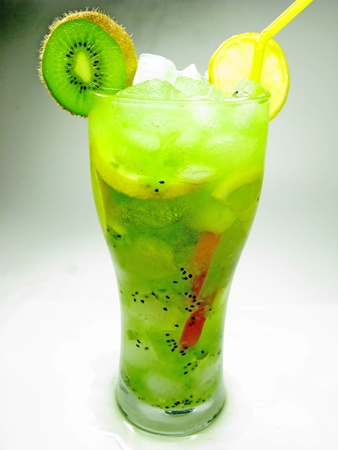 tropical fruit cocktail smoothie with kiwi and ice photo