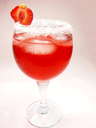 alcoholic red punch cocktail with ice and strawberry photo