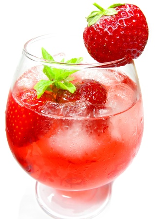 alcoholic punch cocktail with ice and strawberry photo