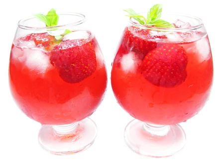 alcoholic strawberry punch cocktails with ice and berries photo
