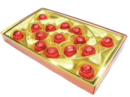 enveloping: sweetmeats in red casing in gold box