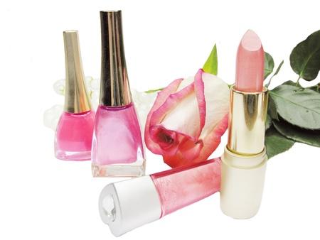 lipstick rose nail polishers and lip gloss make up composition photo