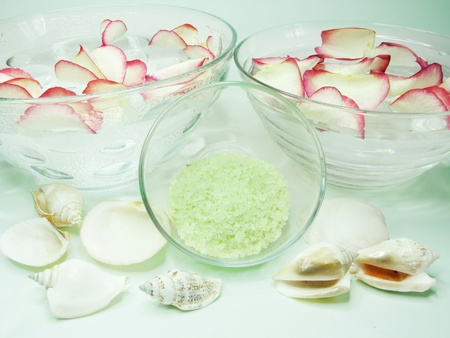 spa lit candles bathing salt sea shells and essences photo