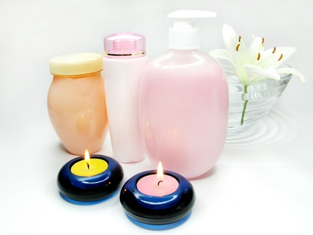 spa hair mask creme liquid soap candles and white lily photo