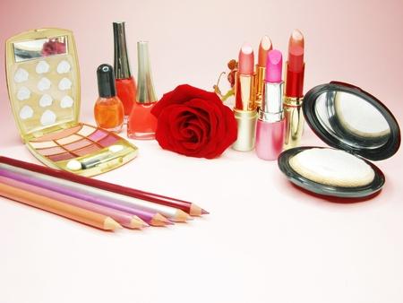 lipsticks rose eye shadows pencils nail polishers lip gloss powder photo