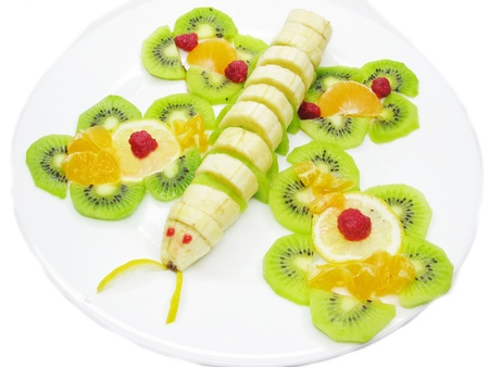 postre de frutas con plátano creativa kiwi y forma de mariposa de color naranja Foto de archivo - 11331671