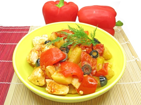 cooked chicken meat with vegetables on bright tablecloth photo