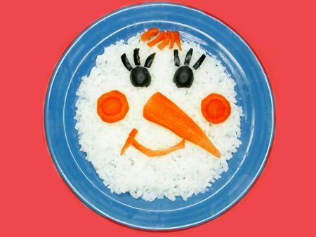 creative rice porridge snowman shape photo