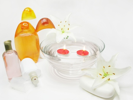 spa hair mask creme shower gel candles essenses and white lily photo