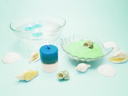 spa lit candles bathing salt sea shells and essences photo