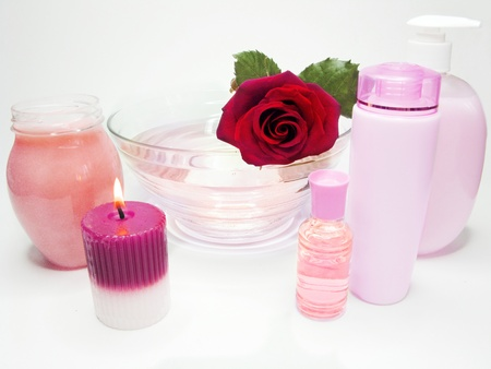 spa hair mask creme liquid soap candles essenses and red rose photo