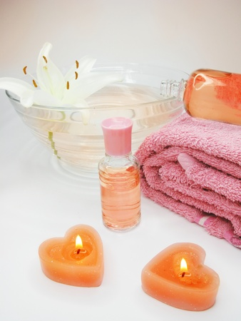 spa candles towel aroma oil essences and white lily photo