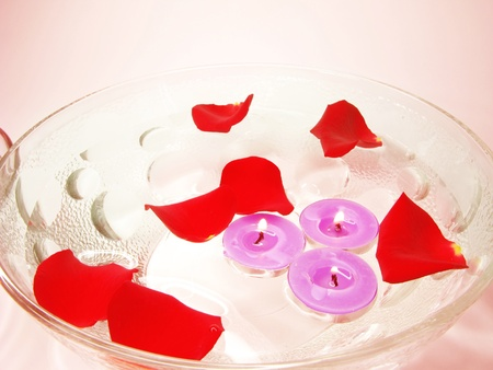 spa lit candles rose petals flowers health-care treatment photo