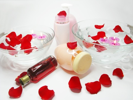 spa hair mask creme liquid soap candles towel essenses among rose petals photo