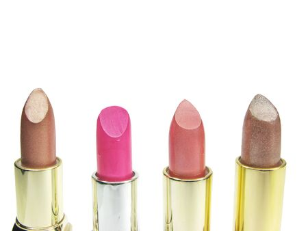 brown and pink lipsticks different color isolated on white background photo