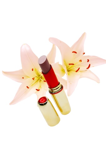 brown lipstick in red box with pink lilies flowers on white background photo