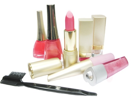 pink lipstick creme eye-shadow nail polishers and lash brush lip gloss photo