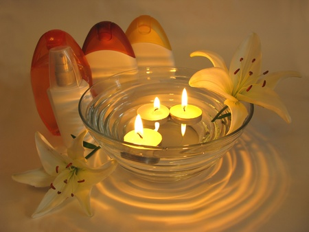 spa lit candles lilies flowers health-care treatment photo