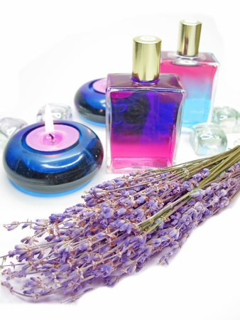 spa lavender oils among flowers and candles photo