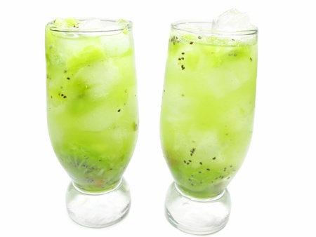 two glasses of fruit green drinks with ice and kiwi photo