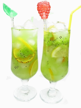 glasses of fruit cocktail smoothie with kiwi lemon and orange tropical mix photo