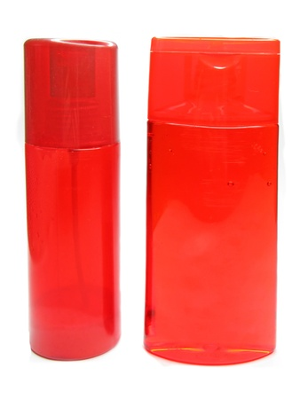 red bottles of shampoo and shower gel photo