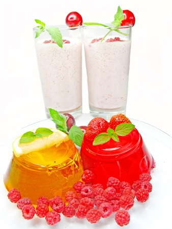 jelly orange and red dessert with raspberry and strawberry and two alcohol cocktails photo