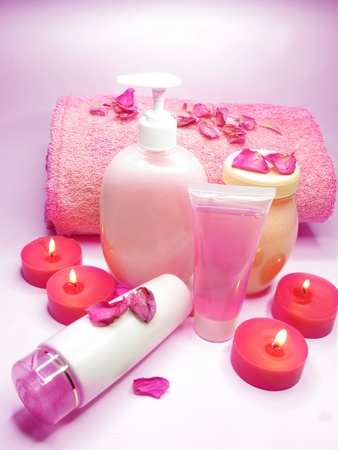 spa candles shampoo shower gel rose petals and cremes photo