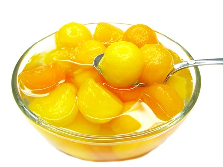papaya fruit in balls in syrup isolated photo