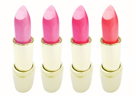 pink lipsticks palette set in gold boxes isolated on white background photo