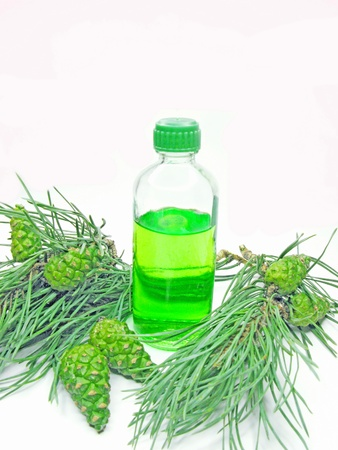 spa aroma green oil bottle with fir natural coniferous extract photo