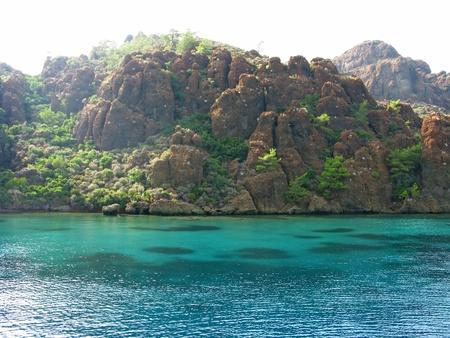 red rocks ans water coastline in aegean sea landscape panorama Stock Photo