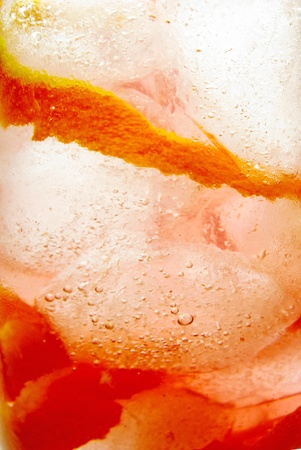 fruit alcoholic cocktail with orange and ice background photo
