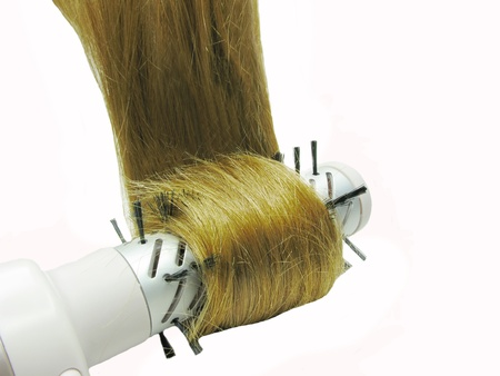 electric dryer: hair brush electric dryer with long dark hair in it