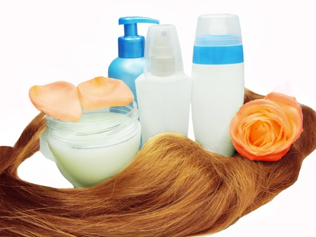 gingery hair wave bottle of tonic shampoo and mask with rose isolated Stock Photo